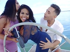 Gorgeous landed gentry are having a ffm threesome on the boat, in the in the midst of the day