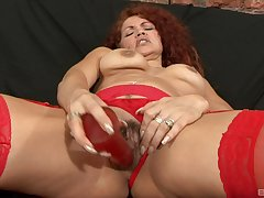 Mature redhead in stockings gets a strapping cumshot alien a coloured dude