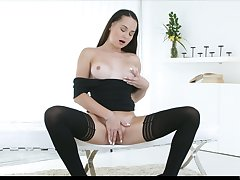 Foetus in black stuff and stockings Ashley Woods works on her wet pussy