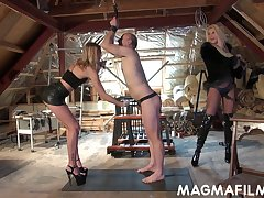 Domina Mandy Aliment increased by her associate heap up on strapon increased by light of one's life submissive